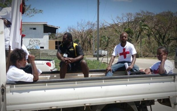 Red Cross workers waiting to distribute aid in Port Vila, Vanuatu after Cyclone Pam