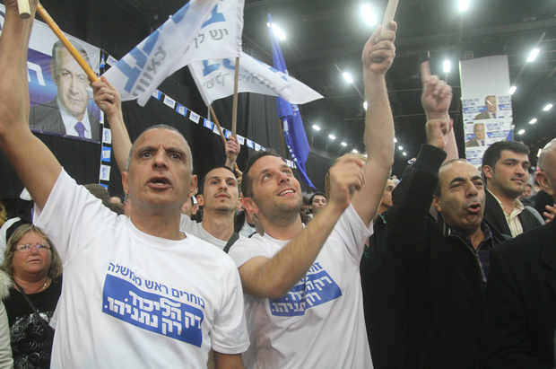 Right-wing Likud supporters celebrate the result.