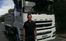 Mitsubishi Fuso's Mike Davidson in front of a HD Euro.