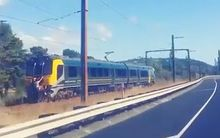 A screenshot from a video showing train-surfing in Wellington.