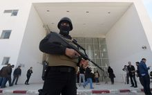 A member of the Tunisian security forces stands guard at the National Bardo Museum
