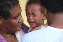 A child in vaccinated for measles in Vanuatu after Cyclone Pam.