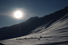Tourists ride dog sleds outside of Longyearbyen, Svalbard, ahead of the 20 March total solar eclipse.