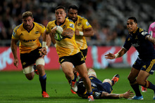 TJ Perenara of the Hurricanes makes a break.