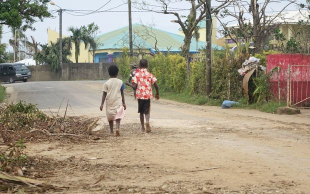 Children walking down a street after vaccination teams visit the area.