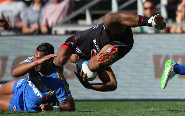 Warriors rookie Solomone Kata takes to the air against the Eels