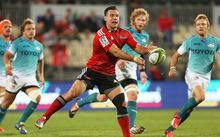 Ryan Crotty of the Crusaders passing the ball against the Cheetahs.