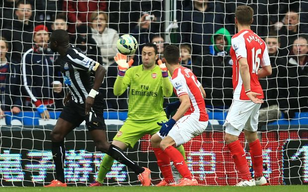 Arsenal goalkeeper David Ospina makes a point-blank save against Newcastle