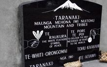A plaque on the Rongo Memorial Rock in Dunedin commemorating the Parihaka prisoners.
