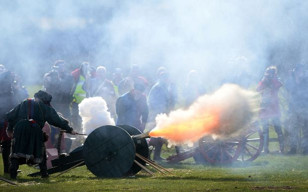 Members of a re-enactment group perform a 21 gun salute during a ceremony for King Richard III.
