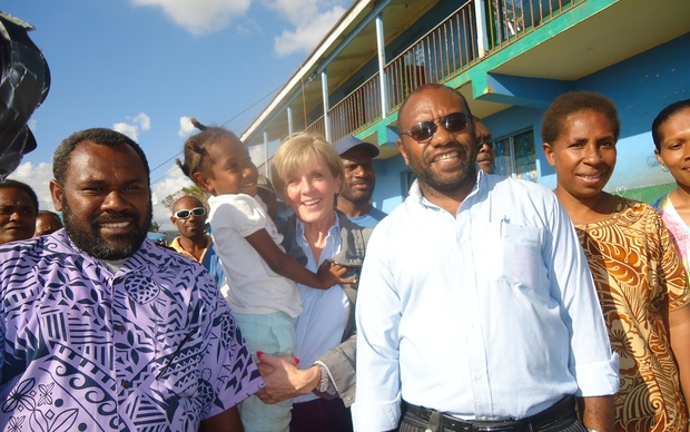 Australia's Foreign Minister Julie Bishop holds a ni-Vanuatu child while visiting in the wake of Cyclone Pam.