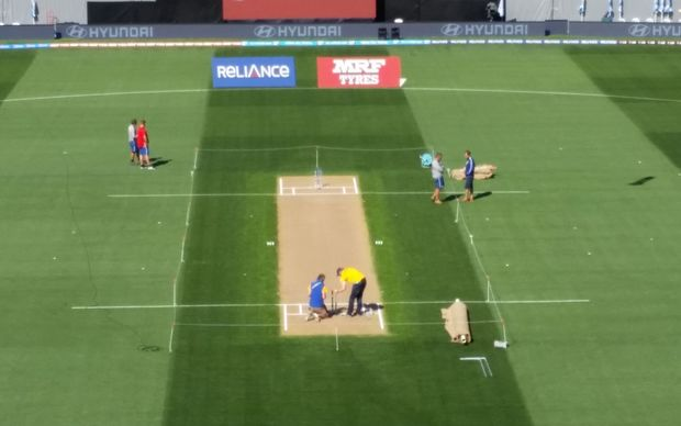 Ground staff prepare the Eden Park pitch ahead of the semi-final.