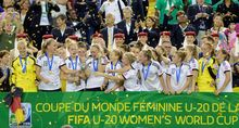 Germany celebrates with the championship trophy during the FIFA Women's U-20 Final at Olympic Stadium in 2014 in Canada. Germany defeated Nigeria 1-0 in overtime