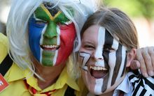 A South African and New Zealand fan ahead of the semi-final match at Eden Park.