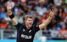 New Zealand bowler Corey Anderson celebrates South African batsman Faf du Plessis being caught by New Zealand keeper Luke Ronchi.