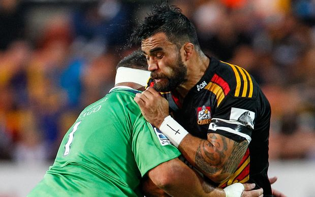 The Chiefs captain Liam Messam is tackled.