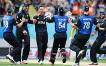 Trent Boult and his Black Caps team mates celebrate a wicket during the World Cup semi final against South Africa at Eden Park.