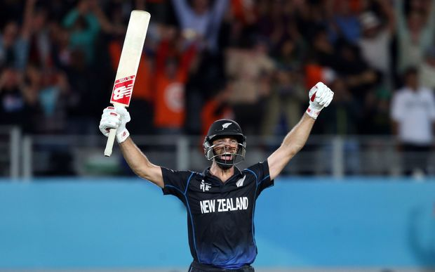 Grant Elliott raises his arms in triumph after hitting the winning six
