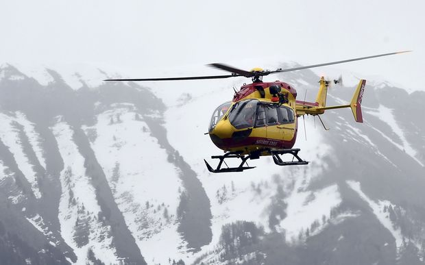 A helicopter participates in rescue efforts in the southeastern French town of Seyne.
