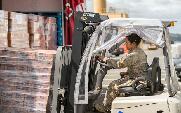 Goods being loaded onto the HMNZS Canterbury before it left for Port Vila.