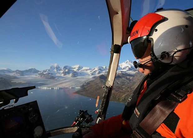 Chief pilot Peter Garden flying on South Georgia Island, with Nordenskjöld Glacier in the background.
