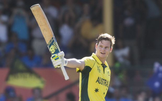 Steven Smith raises his bat after scoring a century against India at the SCG
