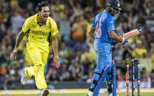Mitchell Johnson tears through the Indian attack.