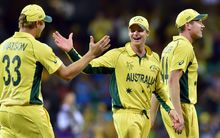 Steve Smith (centre) celebrates victory over India with Shane Watson (left) and James Faulkner (right).