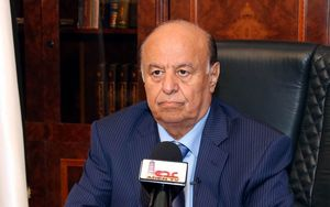 President Hadi speaking to media in Aden on 21 March.