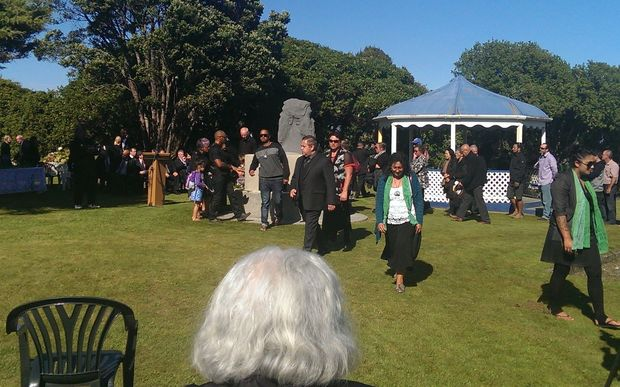 Ngaruahine people gathering in front of memorial stone at Seaview in Hokitika.