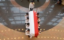 The coffin carrying Lee Kuan Yew's body is transferred from Parliament House for his funeral procession.