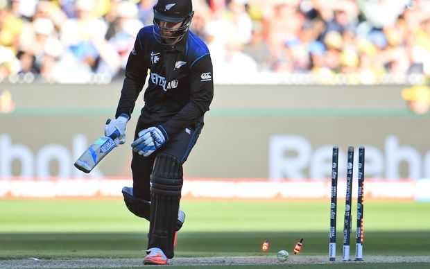 New Zealand batsman Daniel Vettori is bowled by Australia's fast bowler Mitchell Johnson.