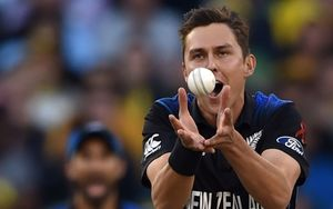 Trent Boult takes a catch off his own bowling to dismiss Australian batsman Aaron Finch.
