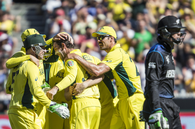 Glenn Maxwell and the Australian team celebrate after getting the wicket of Martin Guptill.