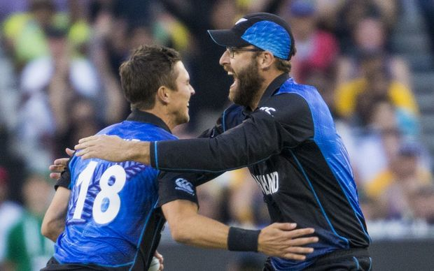 Trent Boult celebrates with Daniel Vettori after getting the wicket of Aaron Finch during the ICC Cricket World Cup Final match.