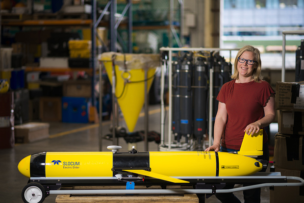 Oceanographer Joanne O'Callaghan stands next to NIWA's new Slocum Glider.