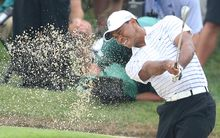 Tiger Woods hits from a bunker the PGA Championship.