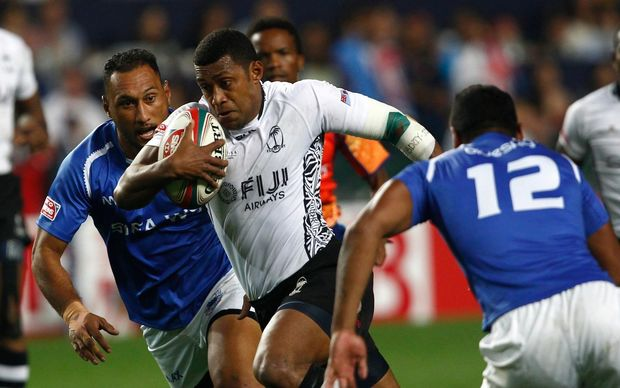 Samoa and Fiji clash in pool play at the Hong Kong Sevens.