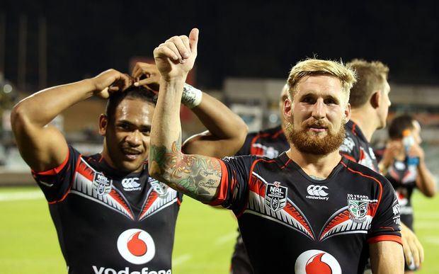 Sam Tomkins and Solomone Kata celebrate a Warriors win.