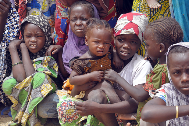 Families fleeing from Boko Haram attacks gather at a refugee camp.