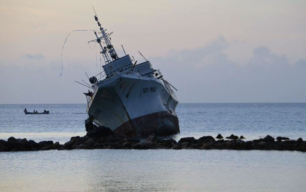 A ship rests on rocks after it ran aground during storms brought on by Super Typhoon Maysak near the coastal village of Neauo on the southern coast of the island of Weno in the Micronesian state of Chuuk. Federated States of Micronesia