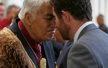 Kaumatua for Hineuru Piri Prentice (left) having a hariru/hongi with Benedict Taylor of the Office of Treaty Settlements.