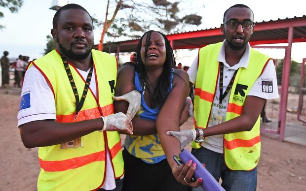 Paramedics help a student injured during the attack by al-Shabaab extremists.