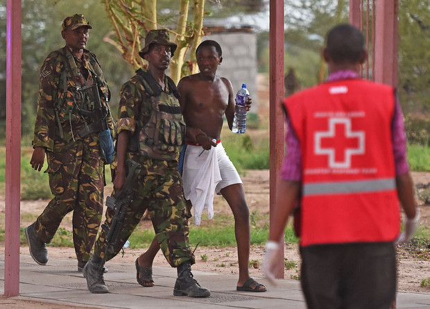 A male student hostage is escorted out of Garissa University.