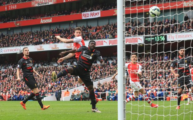 Olivier Giroud heads home the fourth goal against Liverpool