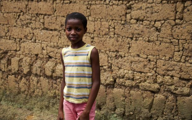 12-year old Rosaline Koundiano pictured in Gueckedou in eastern Guinea, 16 October 2014. Rosaline was one of the first children to survive the ebola virus. It took weeks, however, before she was accepted again into her community.