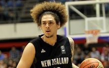 The Tall Blacks forward Isaac Fotu in action.