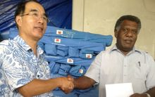 China's Ambassador in Vanuatu, Xie Bohau officially hands over Chinese relief to the Minister of Climate Change, James Bule.