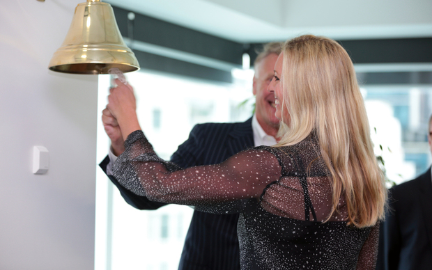 Fliway listing. Chair of Fliway Craig Stobo and shareholder Gretchen Hawkesby ringing the bell at NZX.