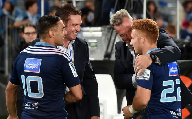 Blues coach Sir John Kirwan congratulates Ihaia West as Dan Bowden and Nick White look on